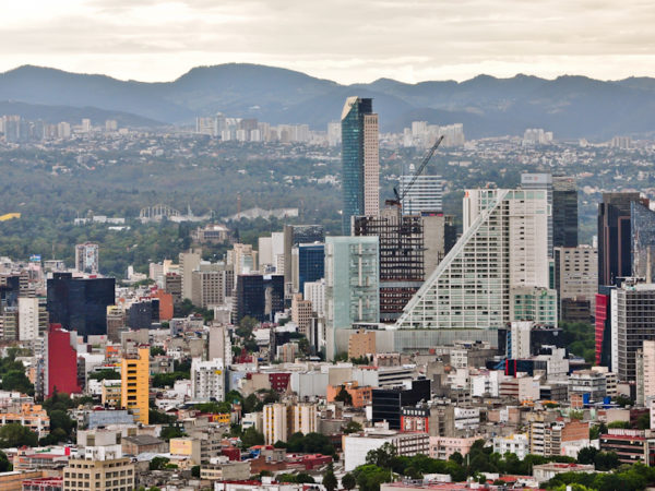 A city landscape with a prominent building at the center.
